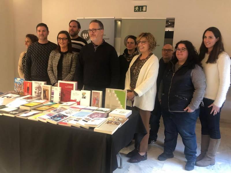 Maria Josep Amigó y Vicent Flor junto con el equipo de Alfons el Magnànim