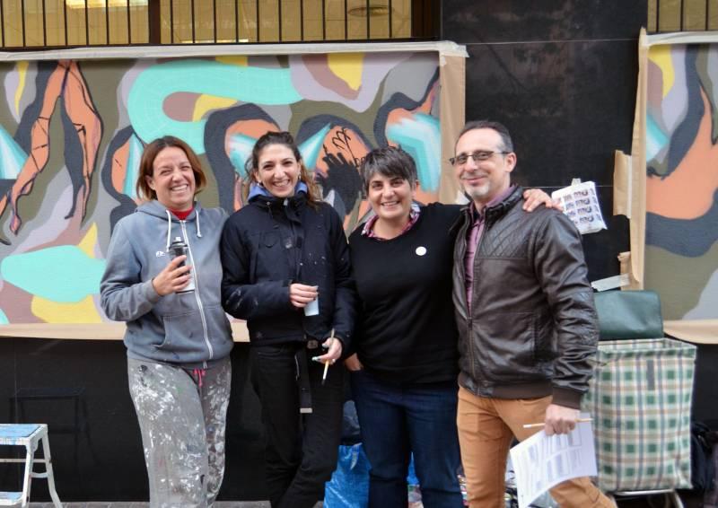 Las grafiteras con el equipo de Lambda